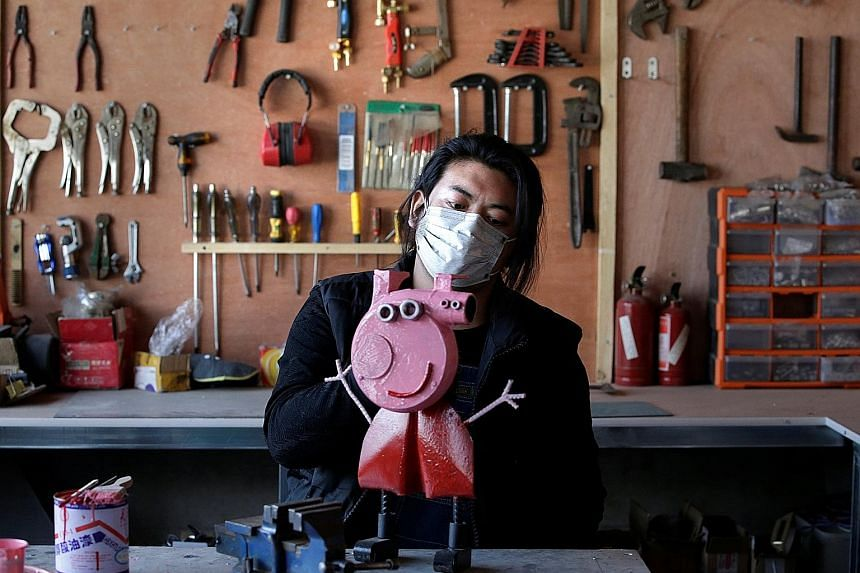 """Mr Geng Shuai, dubbed """"China's Useless Edison"""" by fans, with (clockwise, from left) a sculpture depicting animated series character Peppa Pig, made of an air blower; a cell phone case in the shape of a knife; and a stainless steel handbag in the shap"""