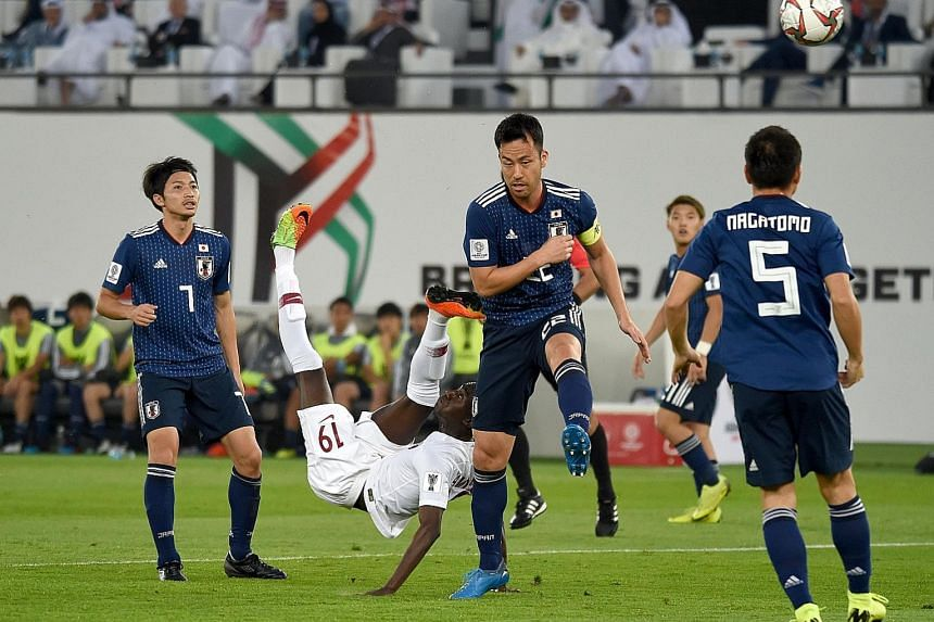 Almoez Ali scoring with an overhead kick in the 12th minute to give Qatar the lead against Japan in yesterday's Asian Cup final at the Zayed Sports City Stadium in Abu Dhabi. His goal bettered Iranian Ali Daei's 1996 tally of eight goals at a single