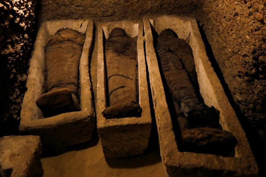 Mummies inside a tomb during the presentation of a new discovery at Tuna el-Gebel archaeological site in Minya Governorate, Egypt, on Feb 2, 2019.