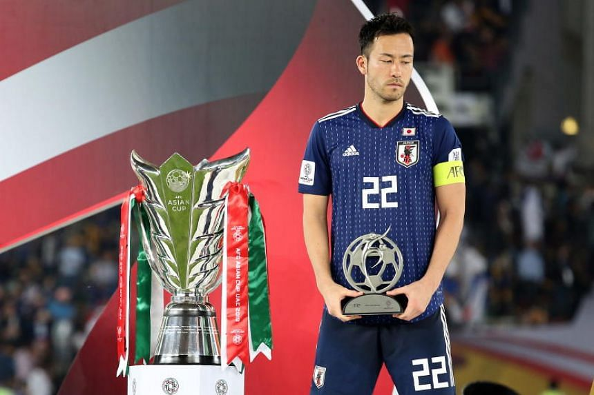 Japan's Maya Yoshida poses with the fair player award trophy after losing the 2019 AFC Asian Cup final match between Japan and Qatar in Abu Dhabi, United Arab Emirates on Feb 1, 2019.