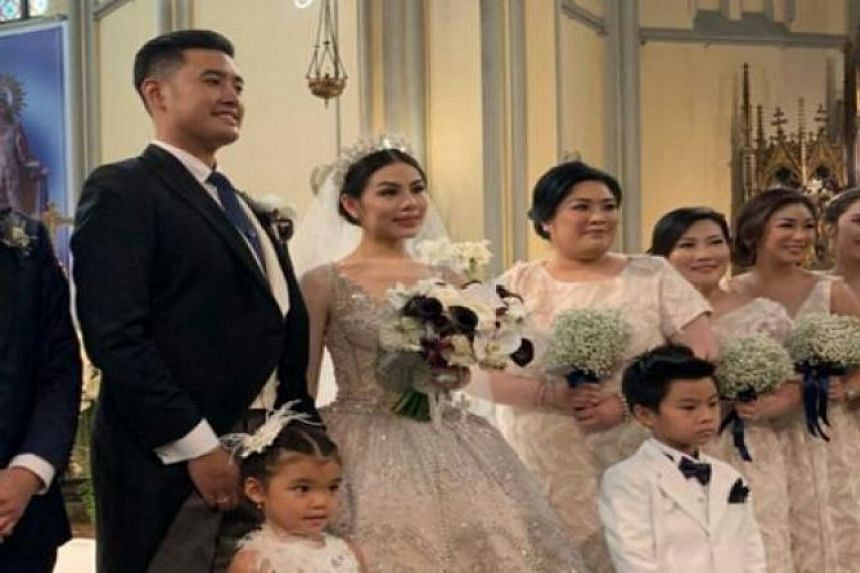In one of several photos in circulation, Mr Richard Muljadi can be seen wearing a black suit next to 28-year-old Shalvynne Chang, who was in a white gown and holding a bridal bouquet.