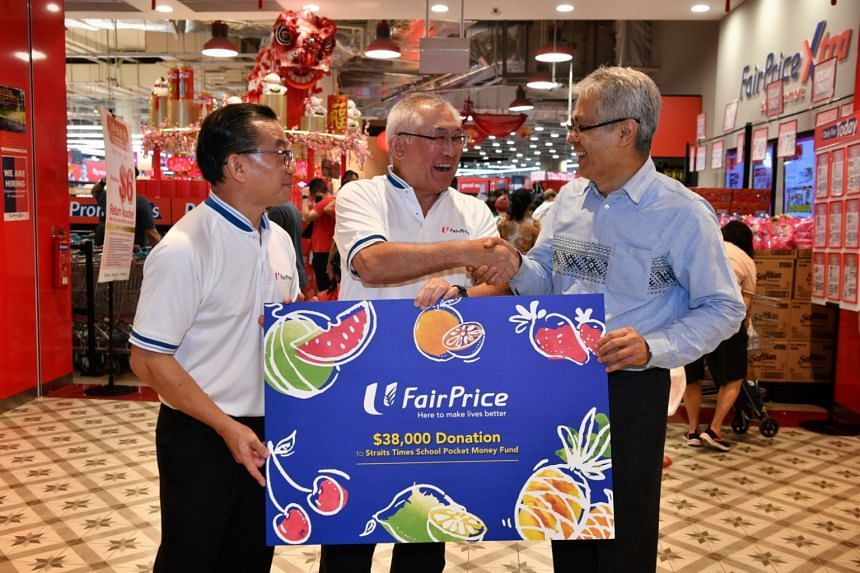 (From left): Cheque presentation by Fairprice CEO Seah Kian Peng and FairPrice Foundation Chairman, Mr Bobby Chin, to the Straits Times School Pocket Money Fund Board Trustee Mr Han Jok Kwang.