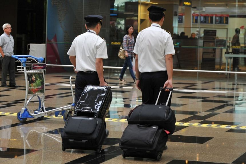Pilots at Changi Airport. CAAS said that random alcohol testing for pilots will be done discreetly and away from the public eye.