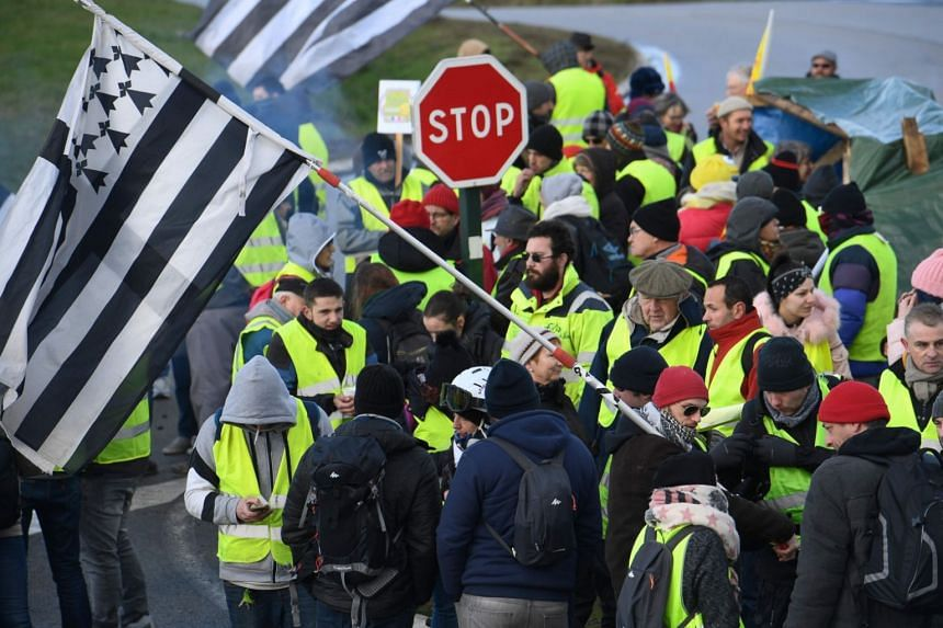 """Protestors taking part in an anti-government demonstration called by the """"yellow vest"""" movement in western France, on Feb 2, 2019."""