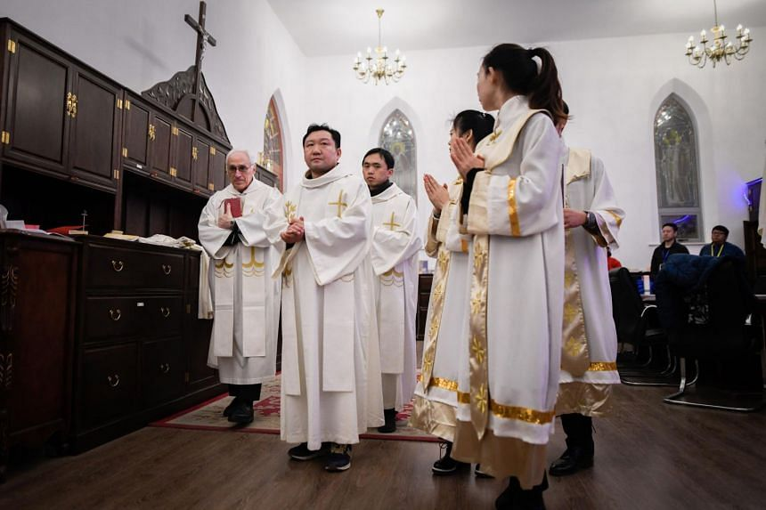 Chinese Catholic clergy prepare to attend a mass during Christmas Eve at a Catholic church in Beijing on Dec 24, 2018.