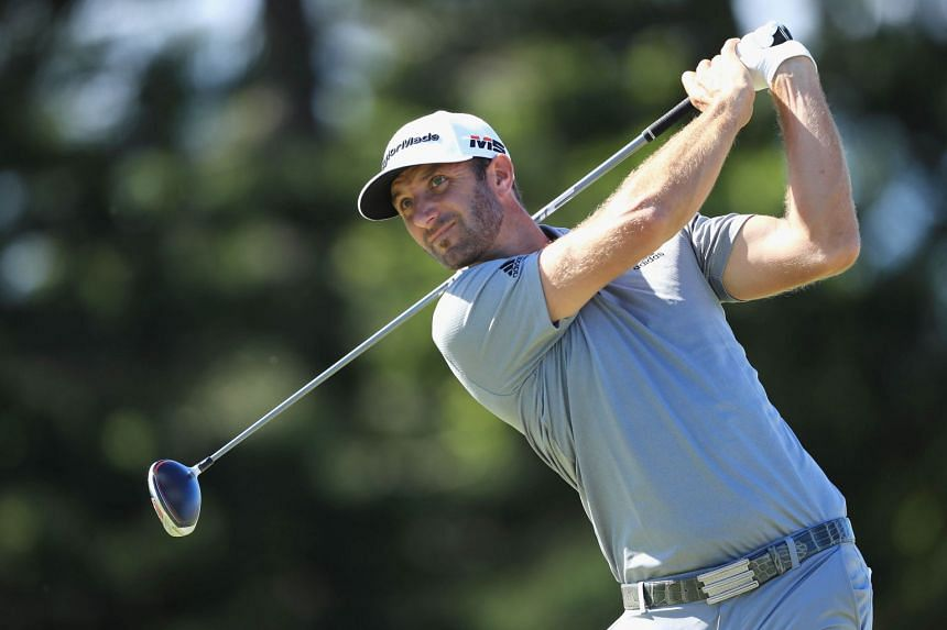 Johnson (above) hit a nine-under-par 61 which hauled him to the top of the leaderboard at 11-under.