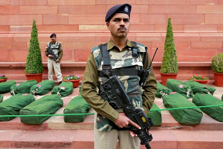 Armed policemen guarding bags containing Budget papers inside the Parliament premises in New Delhi yesterday. The interim Budget contains tax relief for sections of the middle class, a new welfare scheme for farmers and a pension scheme for workers.