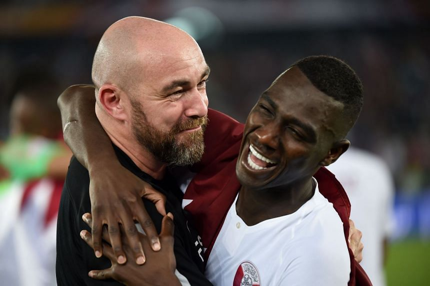 Qatar forward Almoez Ali (right) celebrates with Sanchez after winning the Asian Cup.