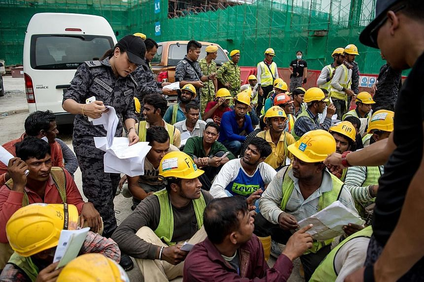 Immigration Department personnel during a raid at a construction site in Kuala Lumpur on Sept 26 to crack down on undocumented foreign workers. Malaysia needs a steady supply of unskilled workers and must repair the damage to the country's reputation