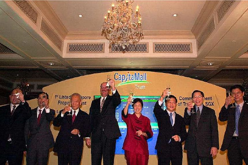 Left: Mr Liew being conferred the French Legion of Honour in Paris in 2017, which honoured his personal achievements and contribution to France's economy. Right: Mr Liew (third from right) at the launch of real estate investment trust CapitaMall Trus