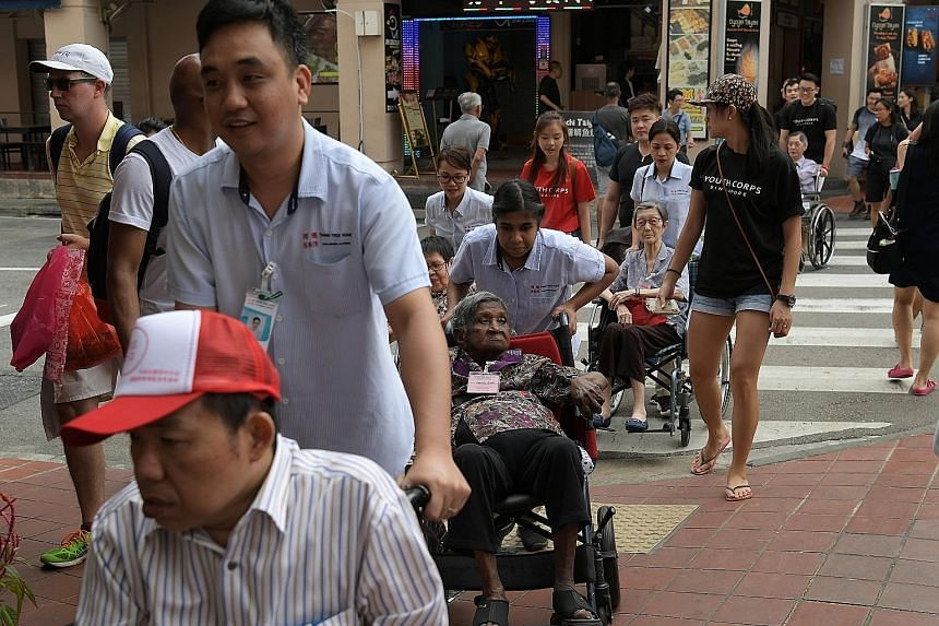 Residents of Thong Teck Home for Senior Citizens, with Jiaksimi volunteers and nursing home staff, on their outing to Chinatown on Jan 26. Started in 2016 and held every couple of months, Jiaksimi gathers volunteers, some as young as 17, to accompany