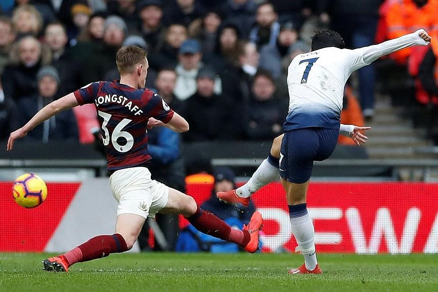 Son Heung-min scoring for Tottenham Hotspur in the 83rd minute to break down a stubborn Newcastle for a 1-0 win at Wembley Stadium yesterday. The win took Mauricio Pochettino's men to within four points of leaders Liverpool, who are in action at West