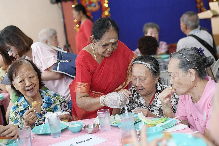 Chinese New Year took on a multicultural flavour yesterday when Singapore's oldest Hindu temple opened its doors for its annual celebration, complete with a lion dance and hongbao distributions. 	Temple volunteer Ayyavoo Sulochana (in red sari), 76,
