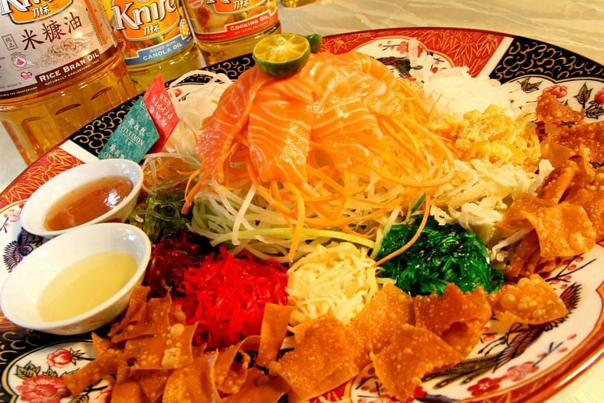 Festive treats like yu sheng (above), bak kwa and pineapple tarts are some snacks that pile on the calories for Chinese New Year revellers.