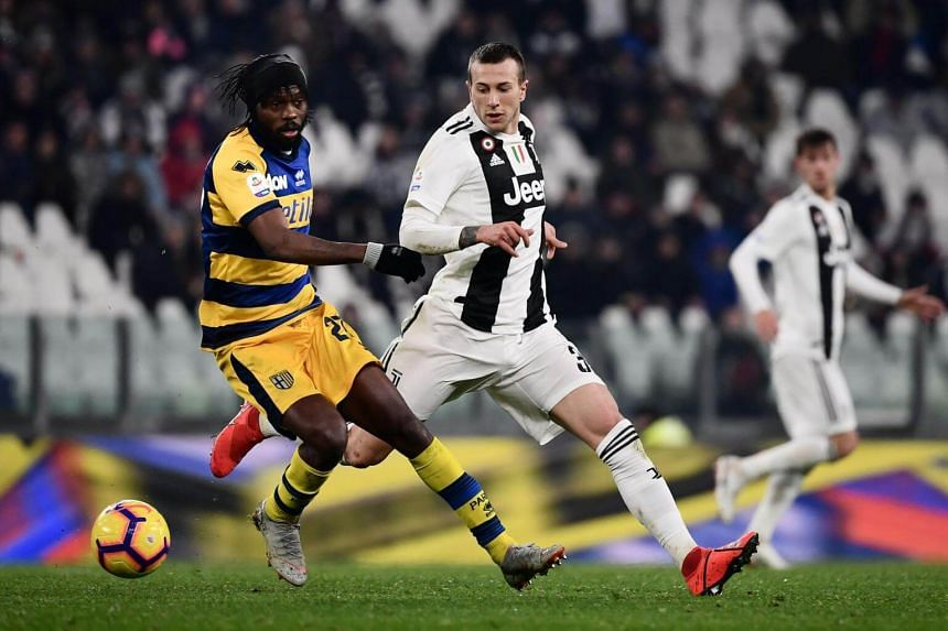 Parma's Ivorian forward Gervinho (left) holds off Juventus' Italian forward Federico Bernardeschi during the Italian Serie A football match at the Juventus stadium in Turin, on Feb 2, 2019.