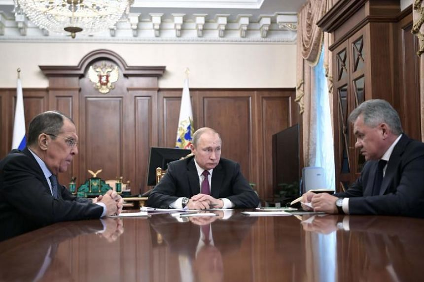 Russia's President Vladimir Putin (centre) attends a meeting with Russia's Foreign Minister Sergei Lavrov (left) and Defence Minister Sergei Shoigu in Moscow on Feb 2, 2019.