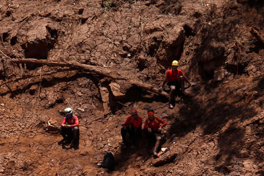 Rescue workers at a search and rescue mission after a tailings dam owned by Brazilian mining company Vale SA collapsed, in Brumadinho, Brazil, on Feb 2, 2019.