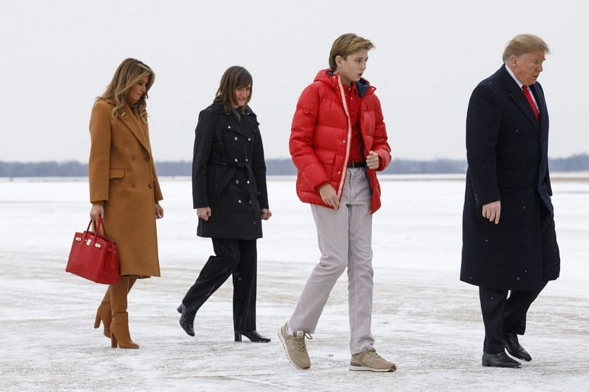 President Donald Trump, first lady Melania Trump, and their son, Barron, arrive at Joint Base Andrews, bound for Trump's Mar-a-Lago Resort in Florida, Feb 1, 2019.