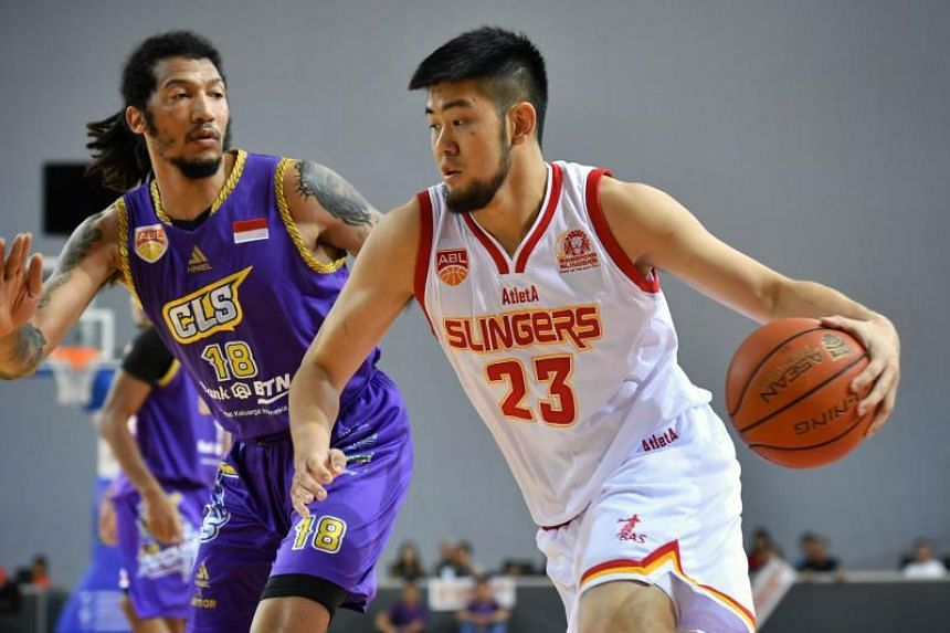 The Singapore Slingers' Delvin Goh dribbles past CLS Knights Indonesia's Maxie Esho during their Asean Basketball League game at the OCBC Arena on Feb 3, 2019.