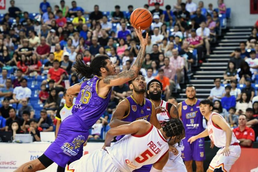CLS Knights Indonesia's Maxie Esho makes a shot during the Asean Basketball League game against the Singapore Slingers at the OCBC Arena on Feb 3, 2019.