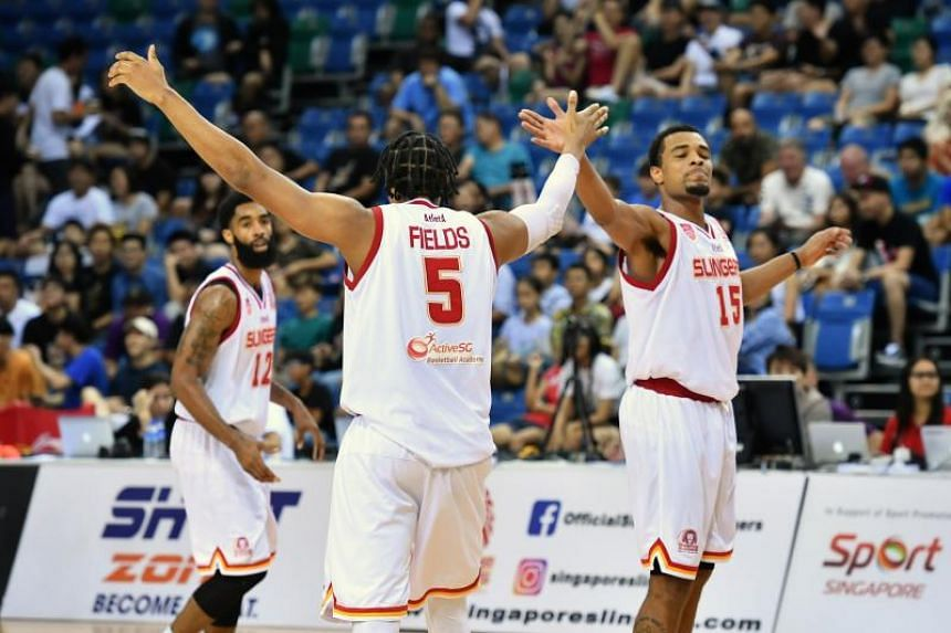 The Singapore Slingers' John Fields celebrates with his teammates after scoring in the Asean Basketball League game against the CLS Knights Indonesia at the OCBC Arena on Feb 3, 2019.