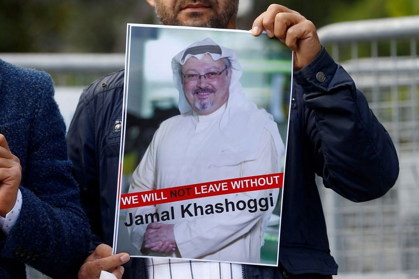 A demonstrator holds a picture of Saudi journalist Jamal Khashoggi during a protest in front of Saudi Arabia's consulate in Istanbul, Turkey.