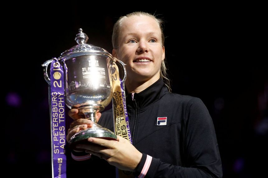 Bertens poses with the trophy after her victory over Croatia's Donna Vekic.