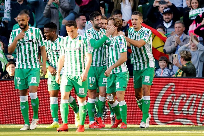 Real Betis' Sergio Canales celebrates scoring with team mates.