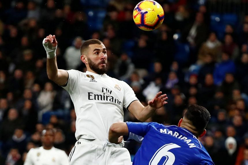 Real Madrid's Karim Benzema in action with Alaves' Guillermo Maripan.