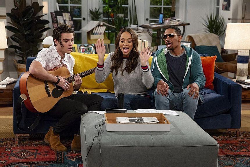 Felix Mallard, Amber Stevens West and Damon Wayans Jr star in Happy Together.