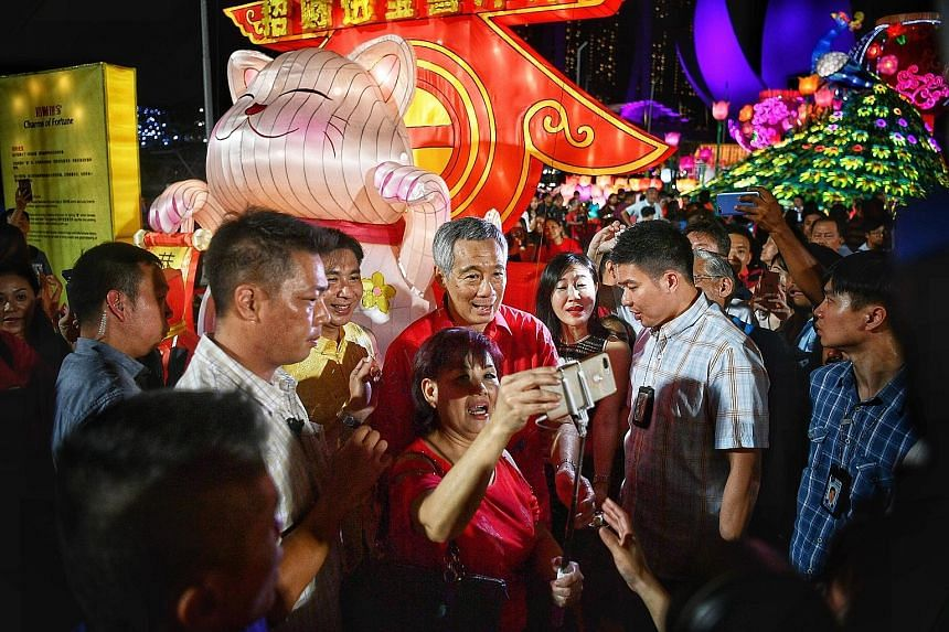 "Visitors enjoying the fireworks display at the launch of River Hongbao 2019 last night. The giant junk boat replica houses an exhibition, ""A Harbour And Home: The Singapore River Through Time"", which highlights the Singapore River's transformation ov"