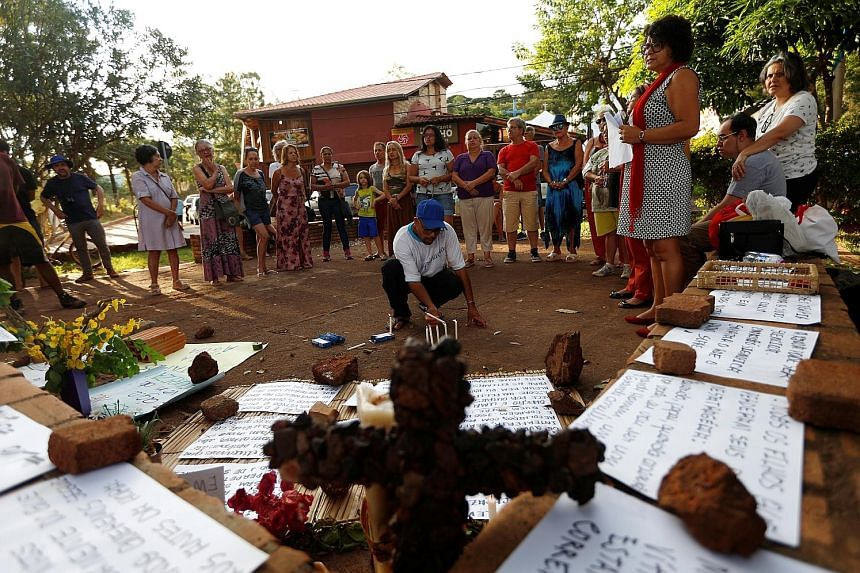 Brumadinho residents holding a memorial service on Saturday for victims of the deadly dam collapse on Jan 25. Virtually all of the 121 dead and 226 missing were workers at the iron ore mine, buried under an avalanche of sludgy mining waste when the d