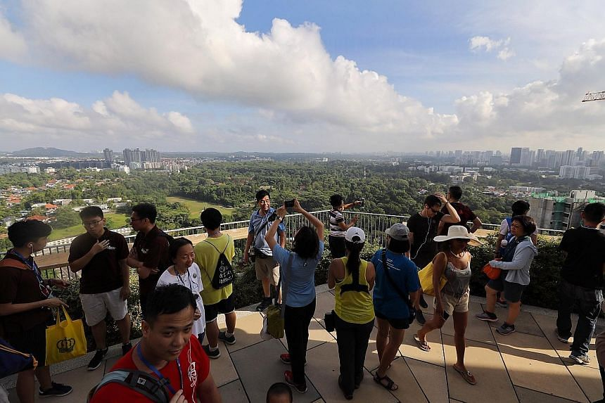 My Dawson Heritage Tour participants taking in the view at the sky garden on the 47th floor of Skyville@Dawson yesterday. The tour features research done by volunteer group My Community, which runs the tour, and insights from past and present residen