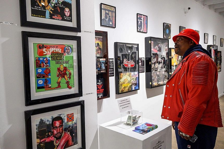 Grandmaster Caz looking at memorabilia at the Hip-Hop Museum Pop-Up Experience in Washington, DC. He wrote parts of Rapper's Delight, which is credited as the commercial start of hip-hop.