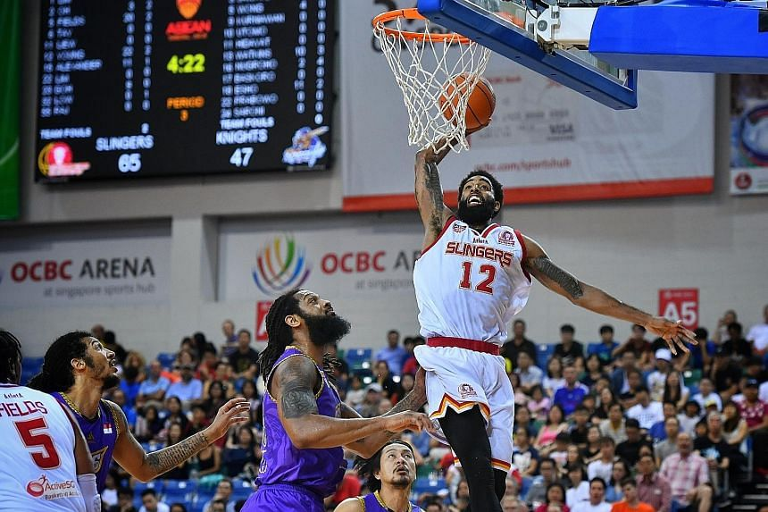 Singapore Slingers' Jerran Young dunking two of his ABL career-high 36 points yesterday. He also had 14 rebounds and seven assists as the Slingers beat the CLS Knights Indonesia 95-76 at the OCBC Arena.