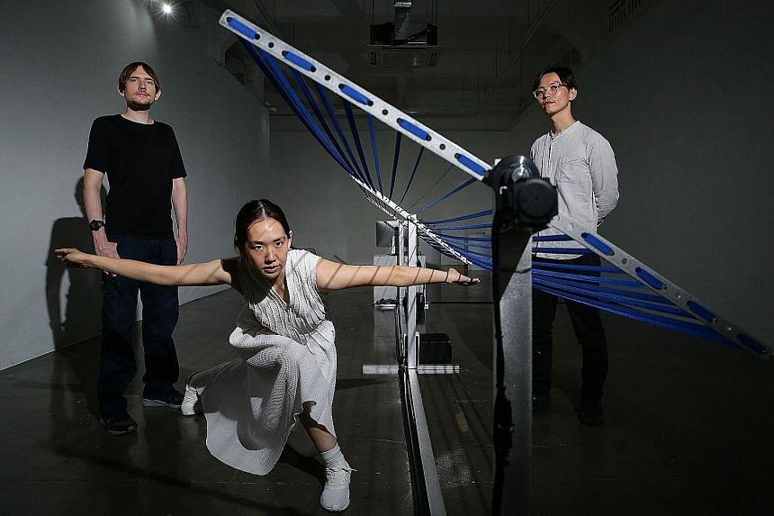 Murasaki Penguin's Anna Kuroda (centre) and David Kirkpatrick (left), and curator Ong Kian Peng (right), with the installation Motion Theory.