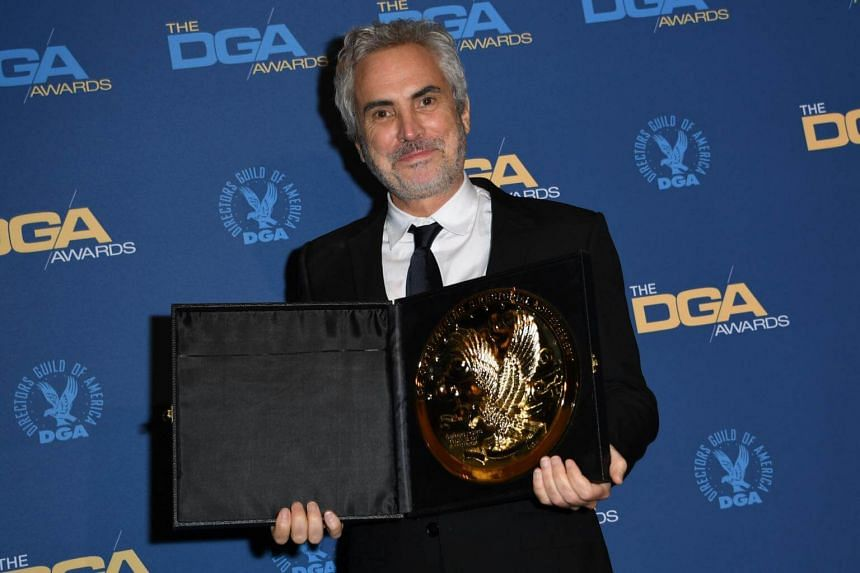 """Director Alfonso Cuaron poses with the award for Outstanding Directorial Achievement in Feature Film for """"Roma"""" in the press room during the 71st Annual Directors Guild Of America Awards at the Ray Dolby Ballroom in Hollywood, on Feb 2, 2019."""