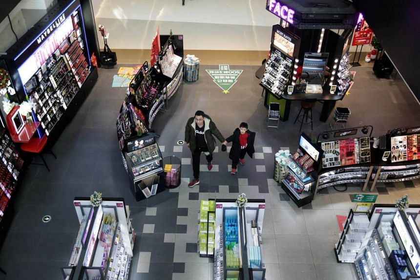 A man and a boy walking in a shopping centre in Beijing, China, on Dec 14, 2018.