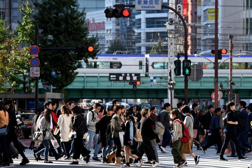 Pedestrians crossing the street at the Shinjuku district in Tokyo, on Nov 14, 2018.