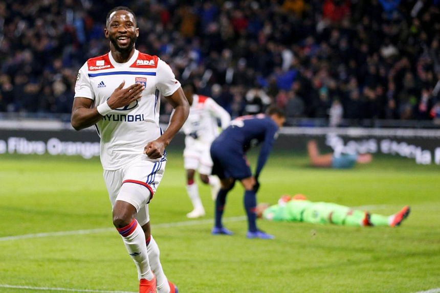 Lyon's Moussa Dembele celebrates scoring their first goal at the Groupama Stadium in Lyon, France, on Feb 3, 2019.