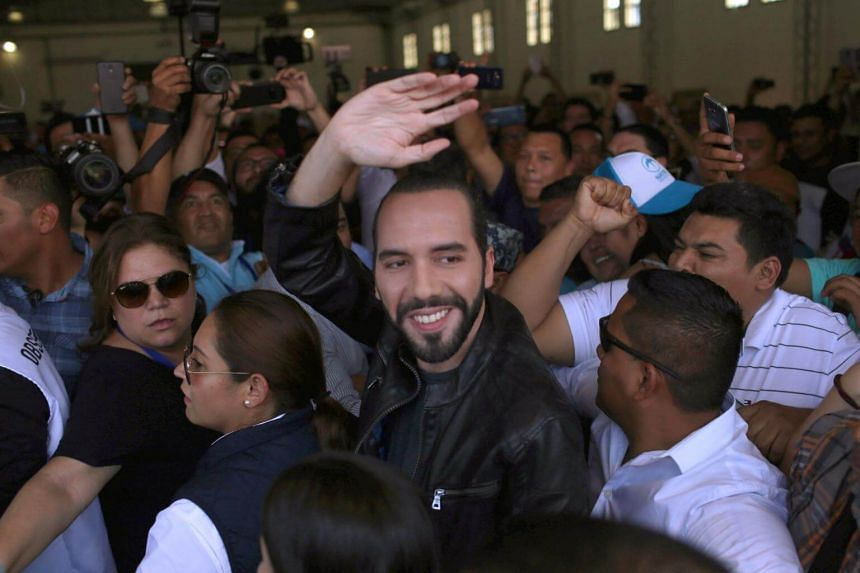 Nayib Bukele waves before casting his vote in a presidential election in San Salvador, El Salvador, on Feb 3, 2019.