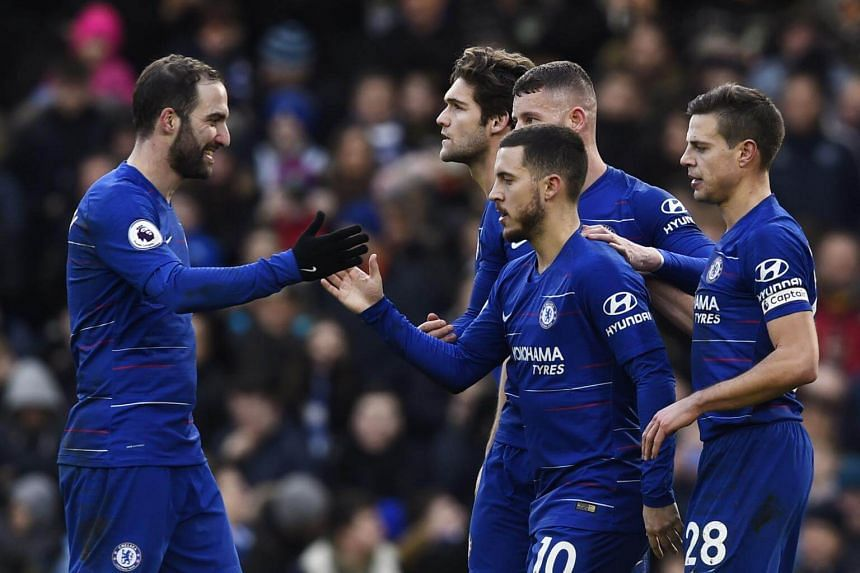 Chelsea's Eden Hazard (centre) celebrates with teammate Gonzalo Higuain after scoring during their English Premier League soccer match at Stamford Bridge, on Feb 2, 2019.