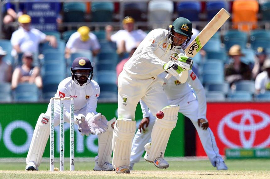 Australia's Usman Khawaja plays a shot during day three of the second Test cricket match between Australia and Sri Lanka at the Manuka Oval Cricket Ground in Canberra, on Feb 3, 2019.