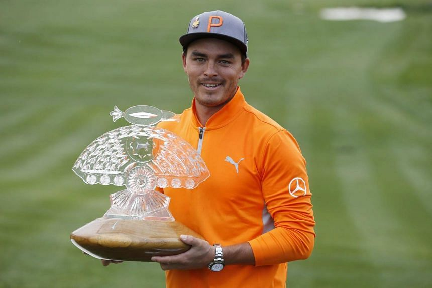 Rickie Fowler poses with the trophy after winning the Waste Management Phoenix Open at TPC Scottsdale on Feb 3, 2019.