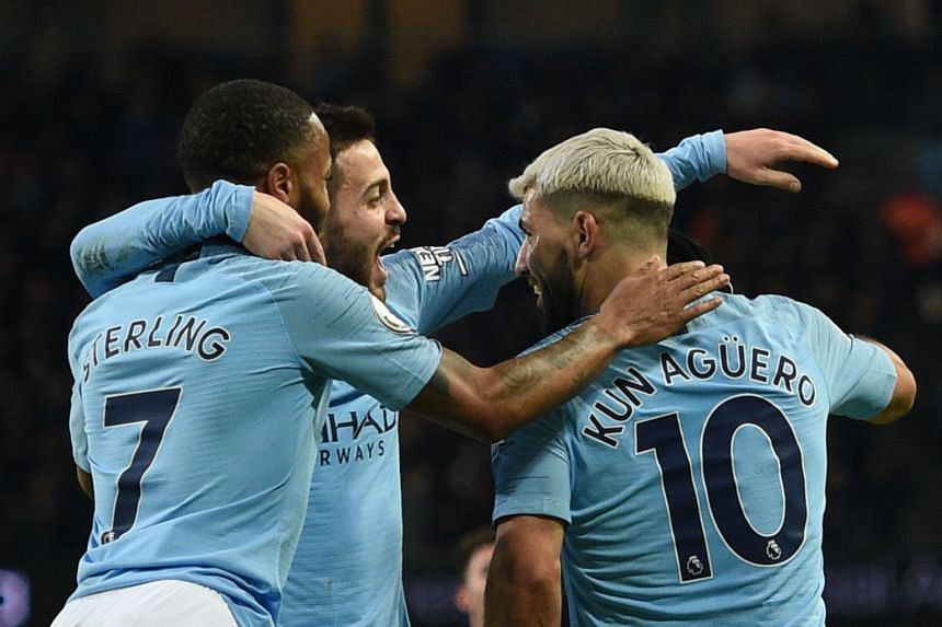 Manchester City's Argentinian striker Sergio Aguero (R) celebrates scoring their third goal to complete his hat-trick.