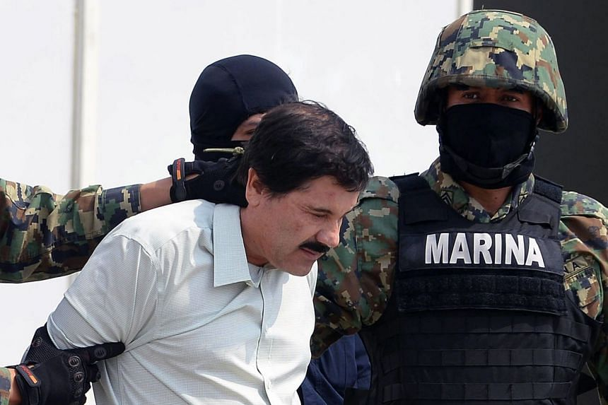 Guzman is escorted by marines as he is presented to the press in Mexico City in 2014.