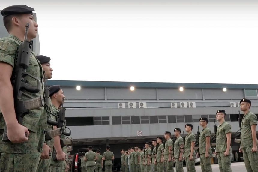 An SAF guard of honour waiting to receive the body of Corporal First Class (National Service) Aloysius, Pang arrived in Singapore on Jan 25. His death while on a training exercise in New Zealand prompted the SAF to call for a safety timeout.