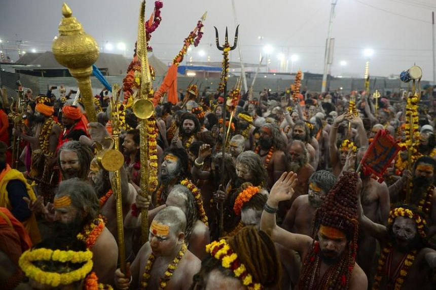 Thousands of Naga Sadhus, a devout, fierce and famously nude sect of followers of the Hindu god Shiv, and other holy men clad in saffron robes, led the mass bathing in the chilly waters, some brandishing swords and tridents.