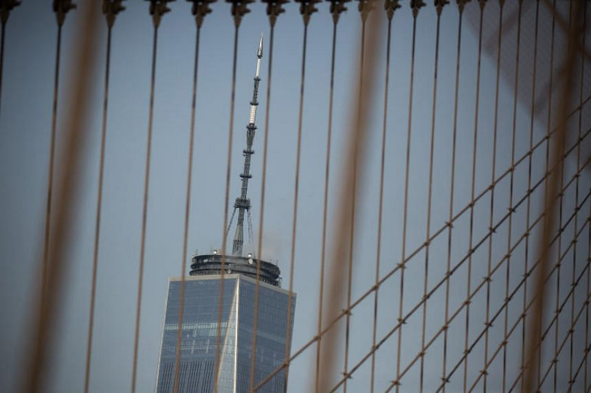 One World Trade Center as seen through the the cables of the Brooklyn Bridge in New York.