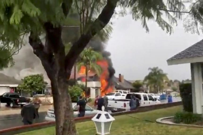 Smoke billows after a plane crashed into a house in a residential neighborhood in Yorba Linda, California, on Feb 3, 2019.